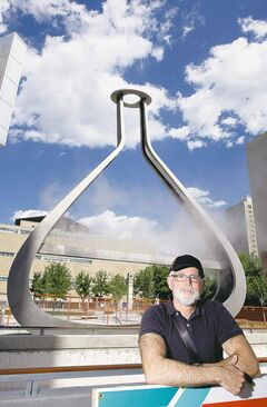 Artist Bill Pechet in front of 'emptyful,'  which is located at the rear of the Millennium Library.