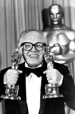 FILE - In this Monday, April 11, 1983 file photo, British actor and director Richard Attenborough holds his two Oscars for his epic movie