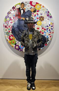 US singer Pharrell Williams poses during a press conference for the exhibition