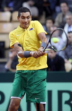 Australia's Nick Kyrgios returns the ball to France's Richard Gasquet during their single match, in the first round of the Davis Cup between France and Australia, in La Roche sur Yon, western France, Friday Jan. 31, 2014.(AP Photo/Remy de la Mauviniere)