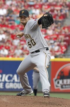 Pittsburgh Pirates starting pitcher Charlie Morton throws against the Cincinnati Reds in the first inning of a baseball game, Saturday, July 12, 2014, in Cincinnati. (AP Photo/David Kohl)