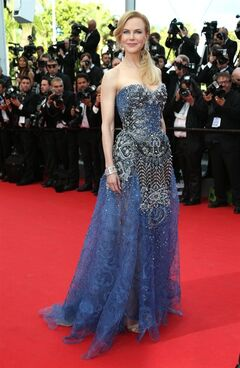 Actress Nicole Kidman poses for photographers on the red carpet for the opening ceremony and the screening of Grace of Monaco at the 67th international film festival, Cannes, southern France, Wednesday, May 14, 2014. (Photo by Joel Ryan/Invision/AP)