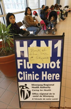 A long line-up at the H1N1 immunication clinic at Portage Place Shopping Center on Friday.