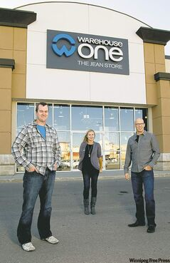 From left, Warehouse One chief operating officer Neil Armstrong, Kenaston store manager Amanda Croy, and director of marketing Larry Millar at the Kenaston store. The chain is breaking sales records and spending millions on rebranding.
