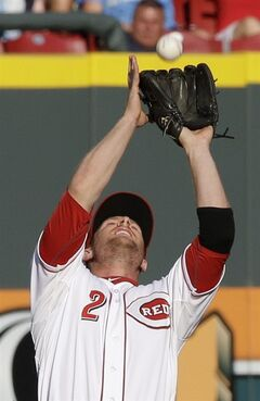 Cincinnati Reds shortstop Zack Cozart catches a fly ball hit by Chicago Cubs' Arismendy Alcantara in the first inning of a baseball game, Wednesday, July 9, 2014, in Cincinnati. (AP Photo/Al Behrman)