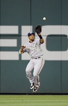 Milwaukee Brewers center fielder Carlos Gomez (27) jumps up to catch a line drive by Washington Nationals' Wilson Ramos for an out during the fourth inning of a baseball game, Friday, July 18, 2014, in Washington. (AP Photo/Nick Wass)