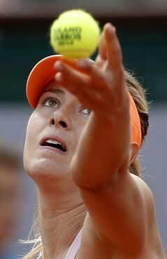Russia's Maria Sharapova serves the ball to Canada's Eugenie Bouchard during their semifinal match of the French Open tennis tournament at the Roland Garros stadium, in Paris, France, Thursday, June 5, 2014. (AP Photo/Darko Vojinovic)