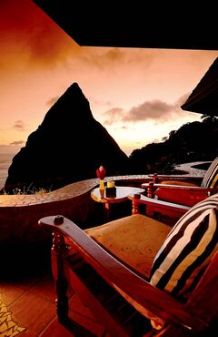 The sunset view of the Piton Mountains from Ladera in Saint Lucia.