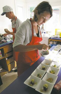 Anna Sigrithur prepares some pickerelcheek appetizers for a recent secret supper -- this one at the St. Norbert Arts Centre.