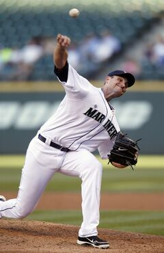 Seattle Mariners starting pitcher Chris Young works against the Minnesota Twins during the second inning of a baseball game on Tuesday, July 8, 2014 in Seattle. (AP Photo/John Froschauer)