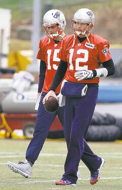 Patriots quarterback Tom Brady (12) and backup quarterback Ryan Mallett at practice Thursday.