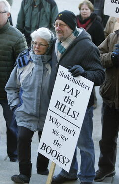 Andy and Sophie Szukiewicz attend a rally at the legislature Thursday.
