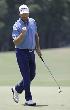 Graeme McDowell, of Northern Ireland, celebrates after a putt on the fourth hole during the third round of the U.S. Open golf tournament in Pinehurst, N.C., Saturday, June 14, 2014. (AP Photo/Eric Gay)