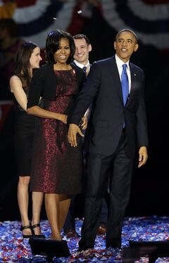 First lady Michelle Obama and President Barack Obama acknowledge their supporters at his election night party Wednesday, Nov. 7, 2012, in Chicago. President Obama defeated Republican challenger former Massachusetts Gov. Mitt Romney. (AP Photo/Pablo Martinez Monsivais)