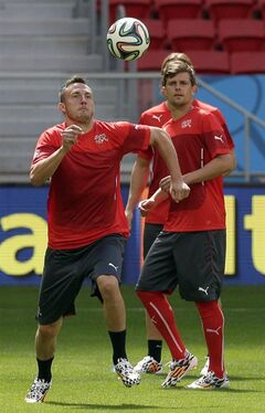 Switzerland's Josip Drmic, left, plays the ball during an official training session the day before the group E World Cup soccer match between Switzerland and Ecuador at the Estadio Nacional in Brasilia, Brazil, Saturday, June 14, 2014. (AP Photo/Michael Sohn)