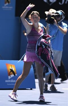 Victoria Azarenka of Belarus walks off the court after her quarterfinal loss to Agnieszka Radwanska of Poland at the Australian Open tennis championship in Melbourne, Australia, Wednesday, Jan. 22, 2014.(AP Photo/Rick Rycroft)