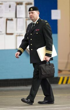 Maj. Darryl Watts (right) arrives for court martial proceedings in Calgary, Alberta on Wednesday, Nov. 14, 2012. Watts has been found not guilty of manslaughter in an Afghanistan training accident that killed a soldier and injured four others. THE CANADIAN PRESS/Larry MacDougal