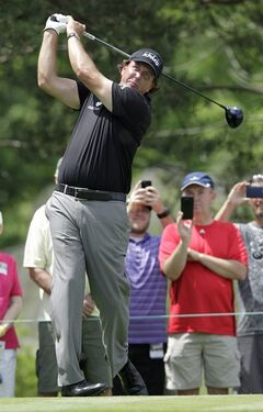 Phil Mickelson tees off on the second hole during the pro-am for the the Memorial golf tournament Wednesday, May 28, 2014, in Dublin, Ohio. (AP Photo/Jay LaPrete)