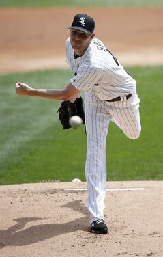Chicago White Sox starting pitcher Chris Sale delivers during the first inning of a baseball game against the Texas Rangers Wednesday, Aug. 6, 2014, in Chicago. (AP Photo/Charles Rex Arbogast)