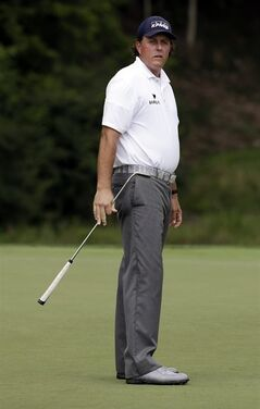 Phil Mickelson watches his putt on the second hole during the third round of the PGA Championship golf tournament at Valhalla Golf Club on Saturday, Aug. 9, 2014, in Louisville, Ky. (AP Photo/John Locher)
