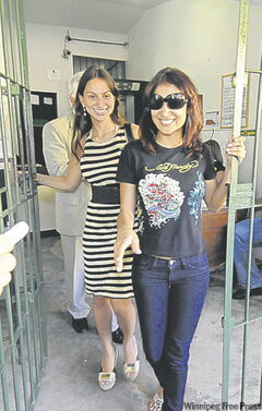 Amanda Rodrigues (front) is released from a women's prison in Recife.