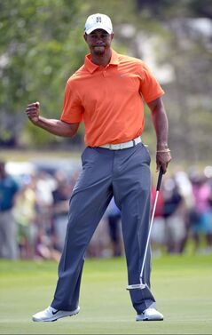 Tiger Woods reacts after sinking a putt for par on the third hole during the second round of the Arnold Palmer Invitational golf tournament Friday. He's got some work to do after a late collapse left him four shots out of the lead.