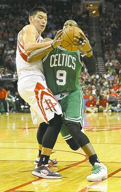 Jeremy Lin (left) defends against Celtics� Rajon Rondo Saturday.