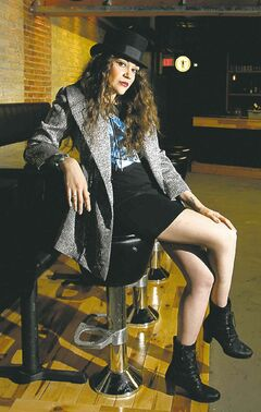 Juno Fashion is the theme and local musicians model the clothes in the Union Sound Hall. This is Sierra Noble.