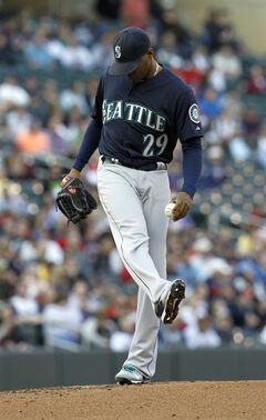 Seattle Mariners starting pitcher Roenis Elias (29) kicks at the mound after giving up a one-run single to Minnesota Twins designated hitter Kurt Suzuki during the first inning of a baseball game, Saturday, May 17, 2014, in Minneapolis. (AP Photo/Ann Heisenfelt)