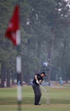 Phil Mickelson hits from the fairway on the 10th hole during the first round of the U.S. Open golf tournament in Pinehurst, N.C., Thursday, June 12, 2014. (AP Photo/David Goldman)