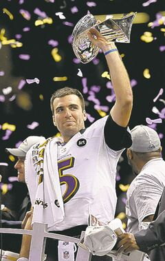 Ravens quarterback Joe Flacco raises the Vince Lombardi Trophy as the Super Bowl MVP.