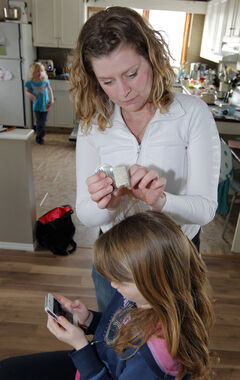 Sarah Phillips demonstrates her treatment for getting rid of mutant lice.