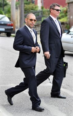 FILE - This July 11, 2013 photo shows Nik Richie, left, owner of the gossip website TheDirty.com, leaving the Federal Courthouse in Covington, Kentucky., with his lawyer, David Gingra, after a jury awarded Sarah Jones $338,000 in her defamation lawsuit against the website. An appeals court is considering whether an Arizona-based gossip website should have been allowed to be sued for defamation by Jones, convicted of having sex with a teenager. Attorneys for both sides argued their case Thursday, May 1, 2014 before the 6th U.S. Circuit Court of Appeals in Cincinnati. (AP Photo/Cincinnati Enquirer, Patrick Reddy) NO SALES