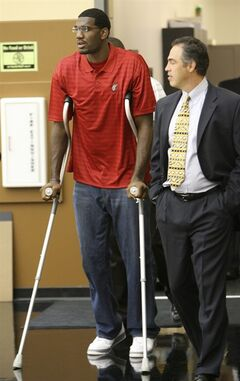 FILE - In this file photo taken Sept. 27, 2007, Portland Trail Blazers center Greg Oden, who underwent surgery on his right knee, walks with crutches with Trail Blazers general managrer Kevin Pritchard before the start of a news conference in Tualatin, Ore. For every Hall of Fame-level big man like Shaquille O'Neal, David Robinson, Tim Duncan and Hakeem Olajuwon, there's a Pervis Ellison, Michael Olowokandi, Kwame Brown and Greg Oden to serve as a cautionary tale. (AP Photo/Rick Bowmer, File)