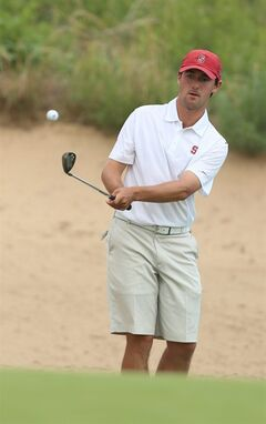 Stanford's Cameron Wilson chips onto the 18th green during the third round of the NCAA national championship Monday, May 26, 2014 at Prairie Dunes Country Club in Hutchinson, Kan. (AP Photo/The Hutchinson News, Travis Morisse)
