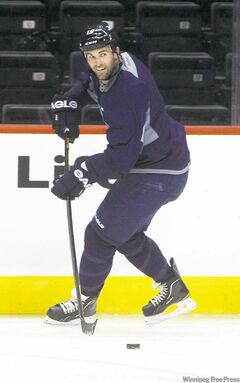 Winnipeg Jets captain Andrew Ladd shoots a pass Sunday in an optional skate at the MTS Centre. He says it's crucial to turn around the losing streak quickly so frustration doesn't build.