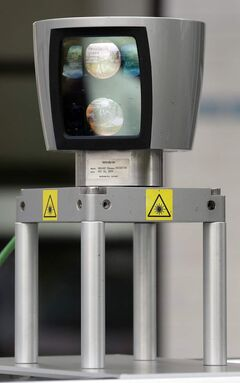 A 360-degree laser scanner is pictured on top of a car Berlin, Germany. The car is driven by a computer that steers, starts and stops itself. The scanner, a GPS system and other sensors monitor the surrounding traffic. A driver sits only for security reasons behind the steering wheel.