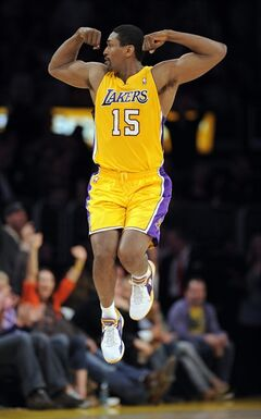 FILE - This March 25, 2011 file photo shows Los Angeles Lakers forward Ron Artest celebrating after dunking the ball during the first half of their NBA basketball game against the Los Angeles Clippers, in Los Angeles. A Los Angeles court commissioner has approved Artest's petition to change his name to Metta World Peace. The bid by the Lakers forward for the new name had been delayed by three weeks so that he could resolve unpaid traffic tickets. With that issue out of the way, Superior Court Commissioner Matthew St. George approved the change Friday, Sept. 16, 2011, during a brief hearing. (AP Photo/Mark J. Terrill, File)