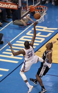 Oklahoma City Thunder forward Kevin Durant shoots after being fouled in the first half of Game 6 of the Western Conference finals NBA basketball playoff series against the San Antonio Spurs, in Oklahoma City, Saturday, May 31, 2014. (AP Photo Brett Deering)