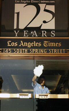 FILE - In this Nov. 16, 2006 file photo, a worker cleans an entrance to the Los Angeles Times building in Los Angeles. Federal authorities allege that Matthew Keys provided hackers with login information to access the Tribune Company's computer system in December 2010. Keys had been fired months before from a Sacramento television station owned by Tribune. Keys was a web producer for KTXL. Tribune also owns the Times. The investigators allege that Keys gave a hacker named