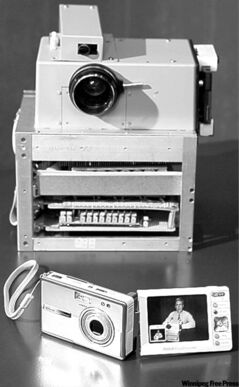 Kodak's first digital camera, built in 1975, next to a modern Kodak EasyShare camera.