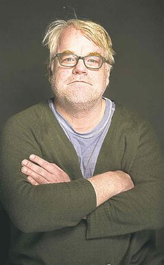 FILE - In this Jan. 19, 2014 file photo, Philip Seymour Hoffman poses for a portrait at The Collective and Gibson Lounge Powered by CEG, during the Sundance Film Festival, in Park City, Utah. Hoffman, 46, who won the Oscar for best actor in 2006 for his portrayal of writer Truman Capote in