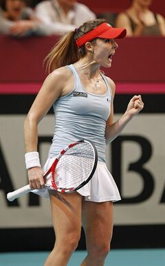 France's Alize Cornet reacts after winning a point during her single match against Switzerland's Belinda Bencic, in the Fed Cup match between France and Switzerland, at the Coubertin stadium in Paris, Saturday Feb. 8, 2014.(AP Photo/Remy de la Mauviniere)