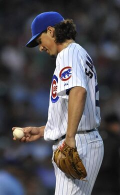 Chicago Cubs starting pitcher Jeff Samardzija looks down at the ball after having given up four runs during the fifth inning of a baseball game against the Washington Nationals in Chicago, Saturday, June 28, 2014. (AP Photo/Paul Beaty)