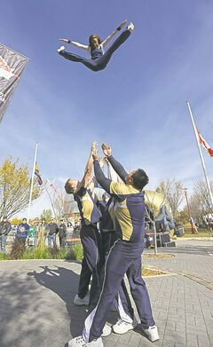 Danessa Picard of the Blue Bomber Cheer Team soars through the air.