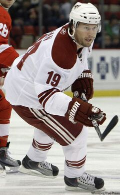 Phoenix Coyotes' Shane Doan keeps his eye on the puck during the first period of an NHL hockey game in Detroit, on Tuesday, Jan. 26, 2010.