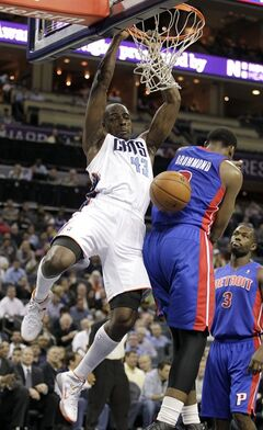 Charlotte Bobcats' Anthony Tolliver (43) dunks over Detroit Pistons' Andre Drummond (0) as Detroit's Rodney Stuckey (3) can only watch during the first half of an NBA basketball game in Charlotte, N.C., Wednesday, Feb. 19, 2014. (AP Photo/Bob Leverone)