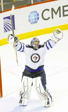 Al Montoya celebrates after  beating the Blackhawks Sunday.