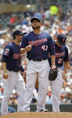 Minnesota Twins starting pitcher Ricky Nolasco (47) tosses a ball after giving up a single to New York Yankees' Kelly Johnson to load the bases during the second inning of a baseball game in Minneapolis, Sunday, July 6, 2014. (AP Photo/Ann Heisenfelt)