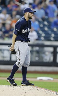 Milwaukee Brewers starting pitcher Marco Estrada reacts after New York Mets' Daniel Murphy hit a two-run home run during the third inning of a baseball game Tuesday, June 10, 2014, in New York. (AP Photo/Frank Franklin II)